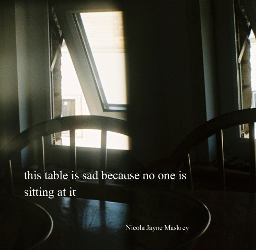 View this table is sad because no one is sitting at it by Nicola Jayne Maskrey